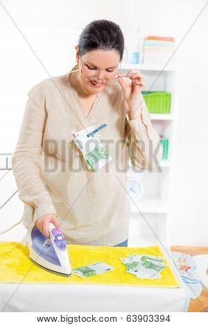 Woman ironing money, money laundering concept