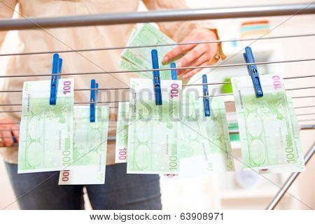 Money laundry, euro banknotes on clothesline