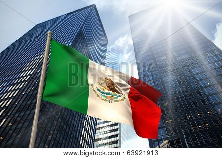 Mexico national flag against low angle view of skyscrapers
