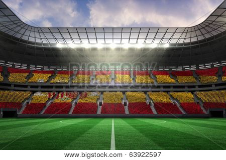Digitally generated spanish national flag against large football stadium