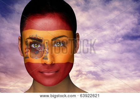 Composite image of beautiful brunette in spain facepaint against scenic landscape with blue cloudy sky