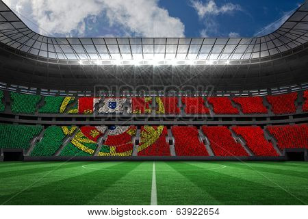 Digitally generated portugese national flag against large football stadium