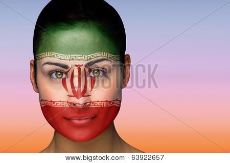 Composite image of beautiful brunette in iran facepaint against beautiful orange and blue sky