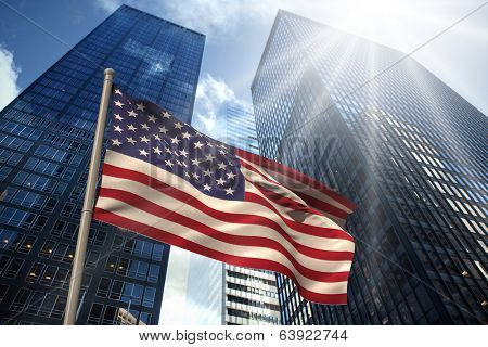 USA national flag against low angle view of skyscrapers