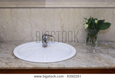 Sink With Flower In A Bathroom