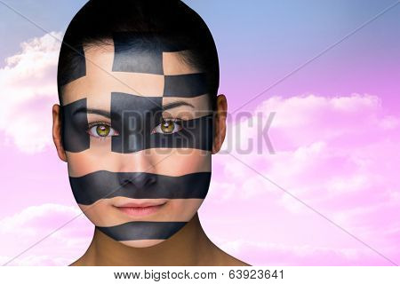 Composite image of beautiful brunette in greece facepaint against beautiful blue cloudy sky