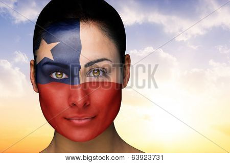 Composite image of beautiful brunette in chile facepaint against beautiful orange and blue sky