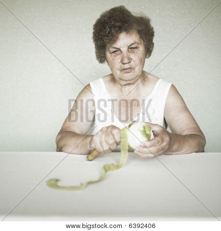 Gracious Senior Lady Portrait With Apple
