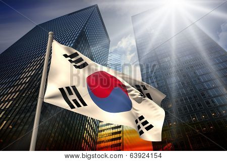 South korea national flag against low angle view of skyscrapers at sunset