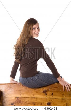 Woman On Back Of Bench Smiling