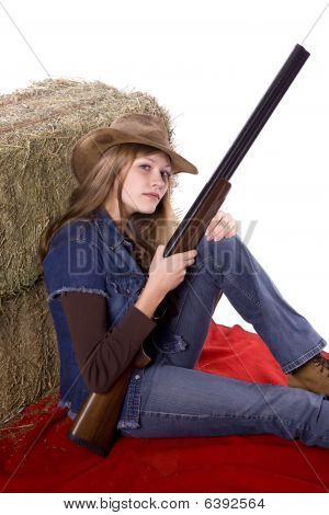 Woman On Blanket Holding Gun