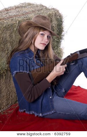 Woman With Gun Sitting