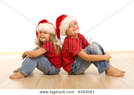 Happy Christmas Kids Sitting On The Floor