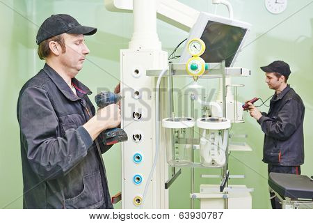 Carpenters joiners with screwdriver mounting equipment at surgery room in clinic