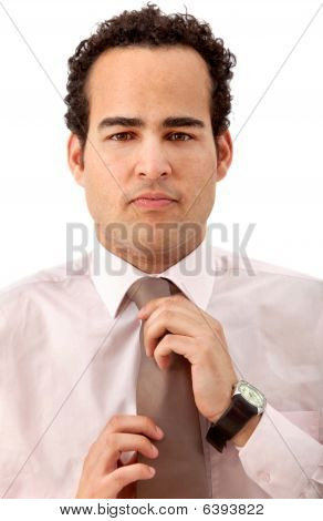 Business Man Fixing His Tie Portrait