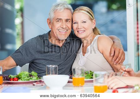Mature couple eating lunch