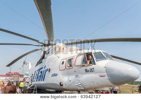 Visitors of airshow explore the MI-26T helicopter