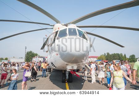 Visitors exploring the MI-26T helicopter