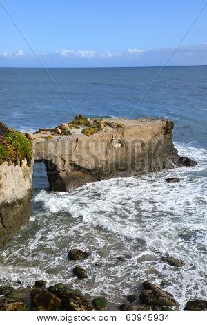 A natural bridge on Cliff Road in Santa Cruz.