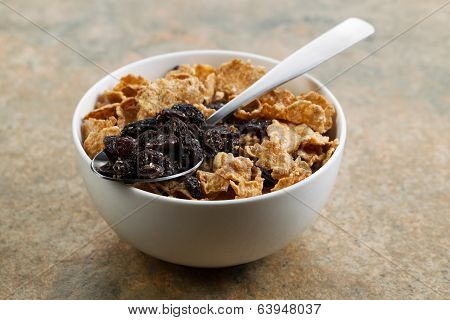Grain Cereal And Raisins In White Bowl