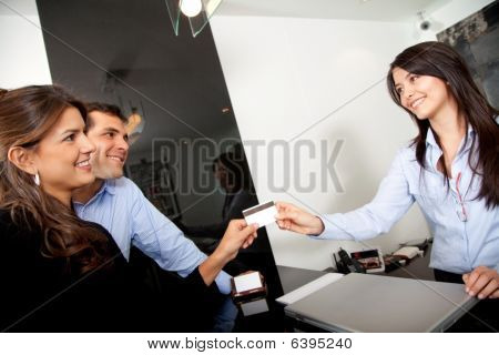 Customers Paying At The Hotel