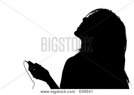 Silhouette With Clipping Path Of Woman Listening To Music