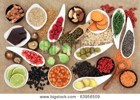 Health food selection over  brown paper background.