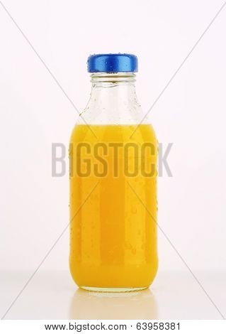 freshly squeezed juice in the bottle with blue lid
