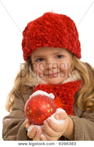 Little Girl With Warm Clothes Holding Christmas Ball