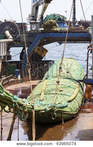 Fishing Vessel. Great Catch Of Fish In Thrall.
