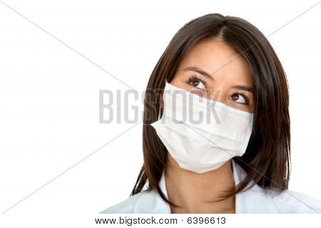 Pensive Doctor With Facemask