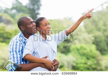 carefree african couple in the forest bird watching