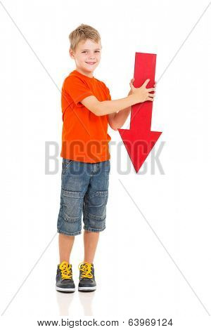 portrait of cute boy holding red arrow pointing down