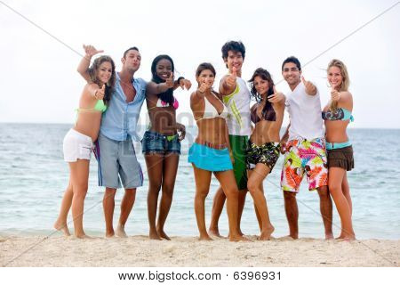Beach People With Thumbs Up
