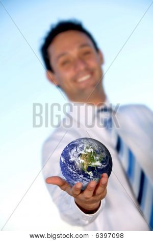 Business Man Holding Earth