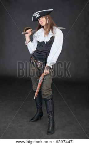 Young Girl In Costume Of Sea Pirate With Sabre And Pistol