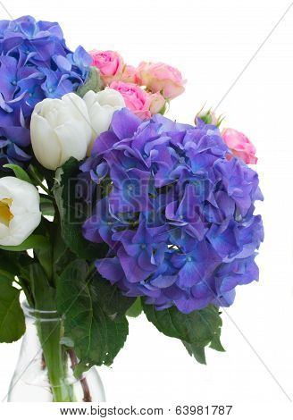 white tulips, pink roses and blue hortensia flowers