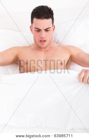 Man Looking Down At His Underwear At His Penis