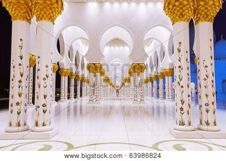 ABU DHABI, UAE - MARCH 27: Columns of Sheikh Zayed Grand Mosque in Abu Dhabi on March 27, 2014, UAE. This is the largest mosque in the United Arab Emirates and the eighth largest mosque in the world.