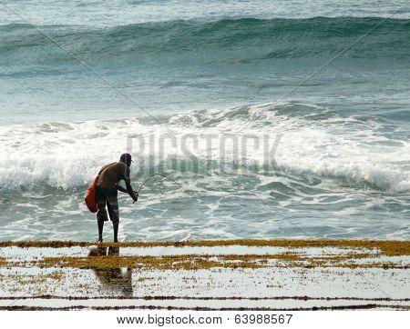 Xai-xai, Mozambique - 11 December 2008: Unknown Man Catches The Bait Fish.