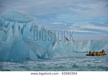 Svalbard, Norway - July 2013: Cruising along Giant Iceberg and Glacier in Nordaustlandet, Svalbard
