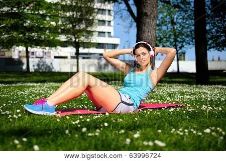 Fitness Woman On Sit Ups Workout