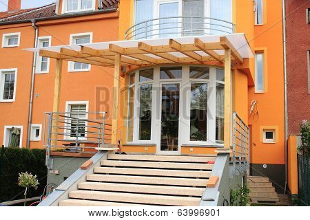 A wooden pergola at the house