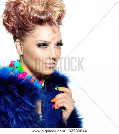 Beauty Woman Portrait in fashion blue fur coat, with Colorful Makeup, Nail polish and Accessories. Colourful Studio Shot of Funny Woman. Vivid Colors