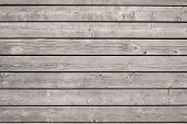 picture of woodgrain  - Background of old wooden weathered unpainted deck planks - JPG