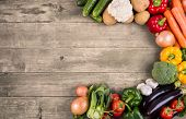 stock photo of carbohydrate  - Vegetables on wood background with space for text - JPG