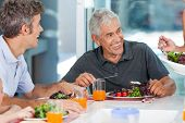 image of mature men  - mature man with family dinner at table