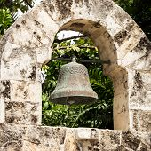 stock photo of playa del carmen  - Antique wrought iron bell in mexican village of Playa del Carmen - JPG