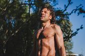 image of chest hair  - Mature long haired athlete getting ready for running - JPG