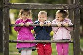 stock photo of playground  - Kids having fun at playground at sunny day - JPG